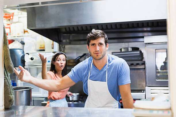 A man and woman in a restaurant kitchen fighting   active shooter preparedness